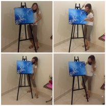 So this is what I end up with in trying to get Abby to take a NICE picture of me next to my latest painting.