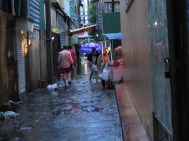 More of the big torrential downpour we had. Our alley was flooded but as you can see, doesn't stop walking through or getting your dinner from the cart!