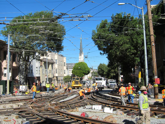 By Monday, the new track had been laid and workers were testing the width of the gauge.