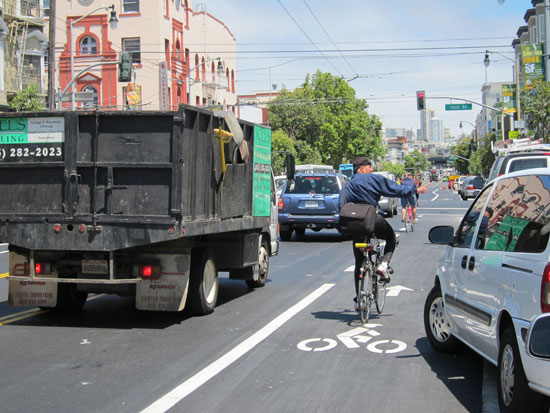 The Valencia Street bike lane on a normal sunny mid-afternoon. The hazards abound, but is it my responsibility to say something to careless cyclists? Photo: Matthew Roth