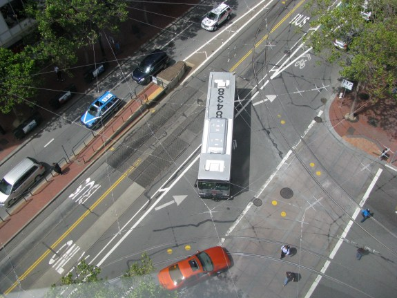 Extending the green bike lane back to the crosswalk is completed by the fact that 11th Street is used by transit, and has tracks where the historic streetcars often pull off. The bike lane could probably not be protected for these reasons, or could it?