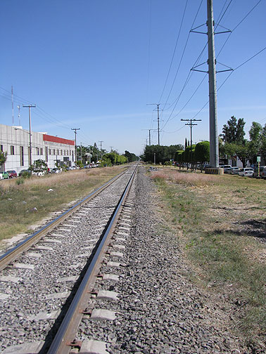 This is the current situation along much of the line. Train tracks down the middle. High tension electric lines on the right, underground gas and oil pipelines under the left.