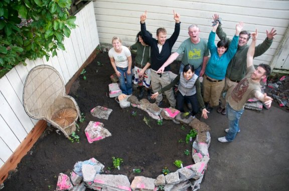 Wigg Party members celebrate a successful Backyard Gardens Work Party. Photo: Jenny Sherman