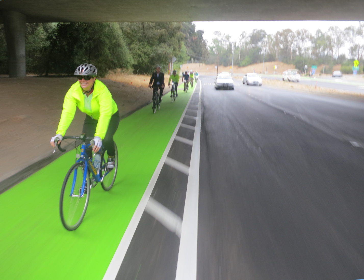 Menlo Park City Council Member Kirsten Keith enjoys the new green and buffered bike lane at Alpine Road and Highway 280. Photo: Andrew Boone