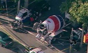 The cement truck was partially blocking the crosswalk after the driver hit the woman. Image: KTVU