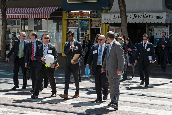 SFMTA Director Ed Reiskin leads state and national transportation officials on a tour today at deadly Market and Sixth Streets. Photo: SFMTA
