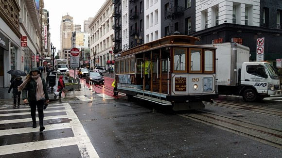 Workers push a cable car on a soggy morning. SFMTA is already rolling back safety improvements on Powell. Photo: Roger Rudick
