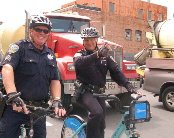 A photo from August 2013. SFPD Chief Greg Suhr, right, gives a thumbs up at a stop light on Seventh Street on yesterday's bike-share celebration ride to City Hall. Photo: Aaron Bialick