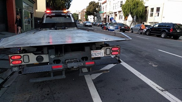 A buffered bike pane on the wiggle. Without concrete. Great place to park a tow truck! Photo: Streetsblog