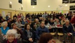 A mostly grumpy audience listens to Supervisor Tang and others talk about proposed improvements to the Taraval line. Photo: Streetsblog.