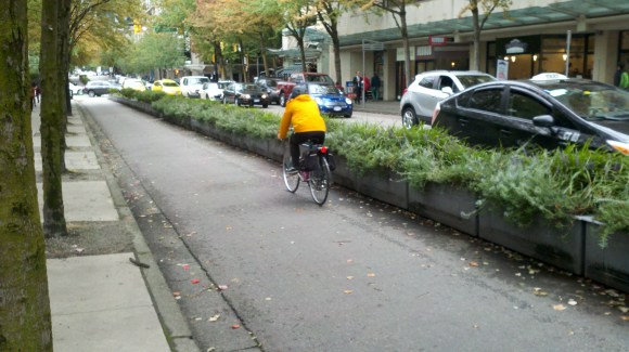 In Vancouver, rather than pain in temporary measures, the put down planters to protect cyclists. Photo: Streetsblog.