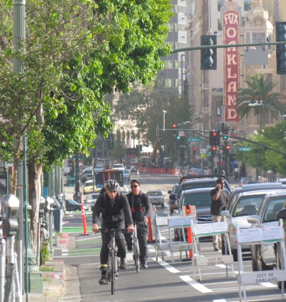 There is a lot going on in the street. Bicyclists now have a safe place to ride without having to mix with car traffic. Photo: Melanie Curry/Streetsblog