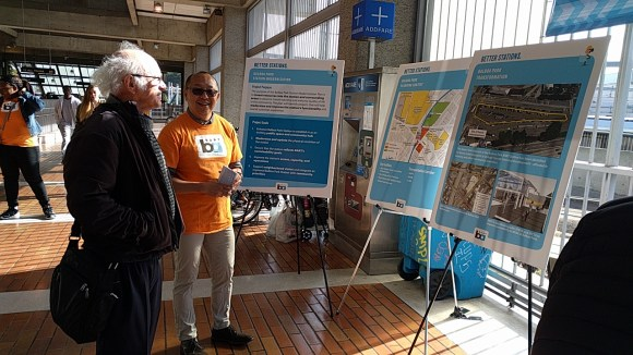 BART Planner Tim Chan explaining station plans and hearing comments from morning commuters at Balboa Park Station. Photo: Streetsblog.