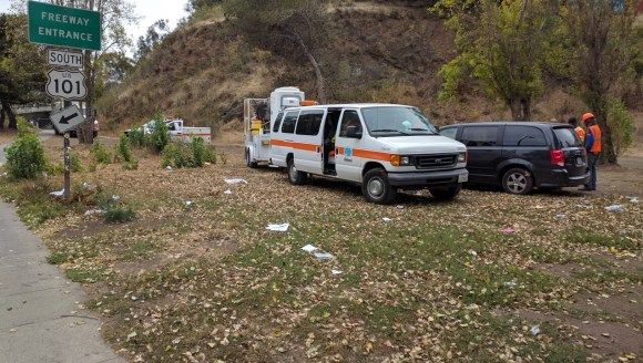 A Caltrans crew was taking a break from cleaning the area around and beneath the hairball this morning. Photo: Streetsblog.