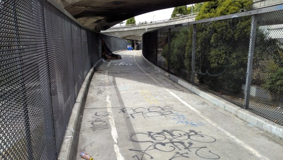 Streetsblog reader Dan Crosby reported some progress in clearing up the hairball bike bridge. Photo: Streetsblog.