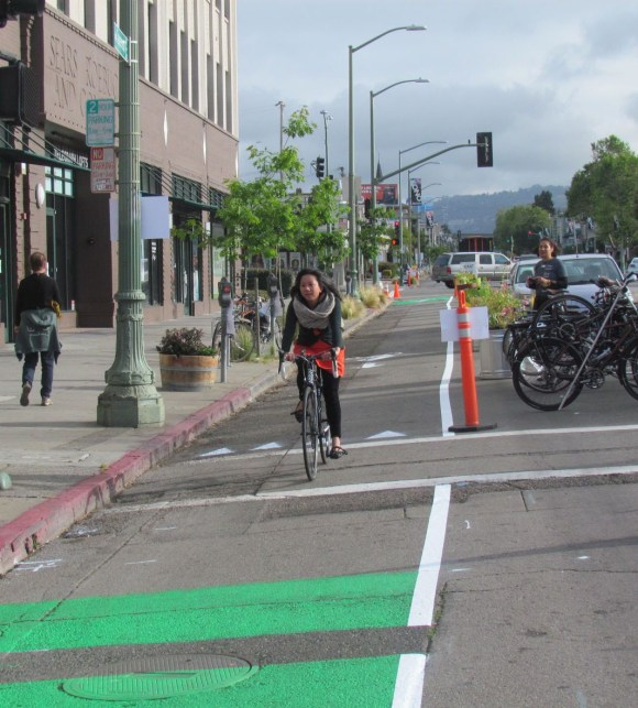 Oakland will be getting more parking-protected bike lanes like this one demonstrated by Bike East Bay. But will the potholls get repaired? Photos: Melanie Curry