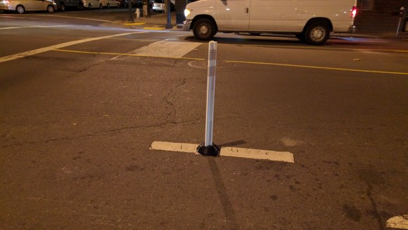 Safe hit posts such as these cost about $30 and glue down in a minute. Photo: Streetsblog