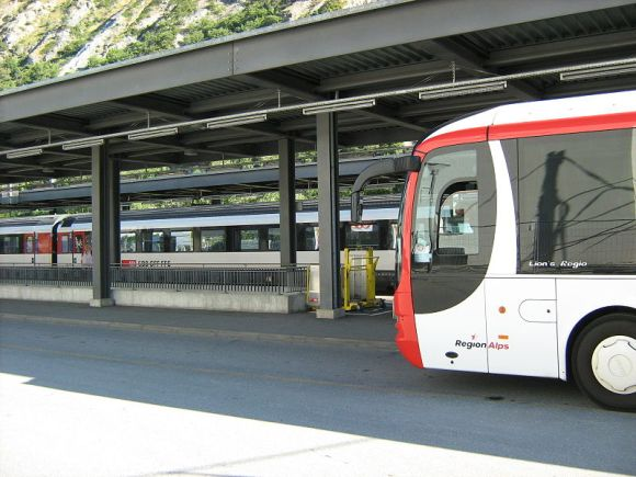 Transfers between buses and trains must be planned and seemless, as seen here in Leuk, Switzerland. Photo: Wikimedia Commons