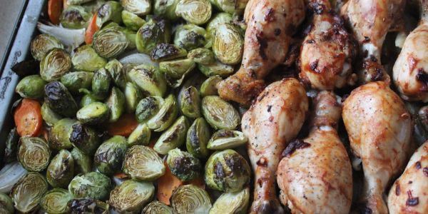 Roasted Barbecue Drumsticks With Brussels Sprouts and Carrots, a recipe created by writer Ivy Manning. (Nathan Hostler, Special to The Oregonian/OregonLive)