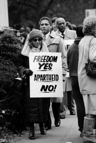 Rosa Parks protests apartheid at So. African embassy DC c. 1985 by Jim Hubbard