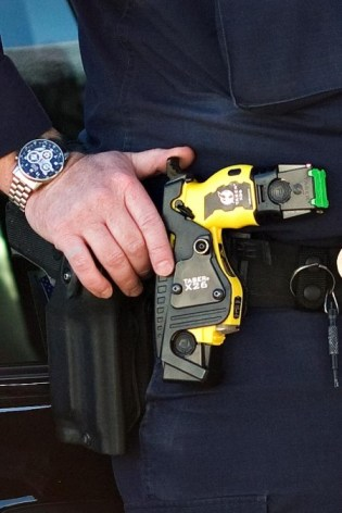 Taser in white cop's belt