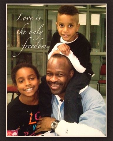 Bomani card w children 'Love is the only freedom'