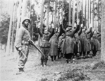 Black US soldier captures German soldiers 0445 by Office of War Information