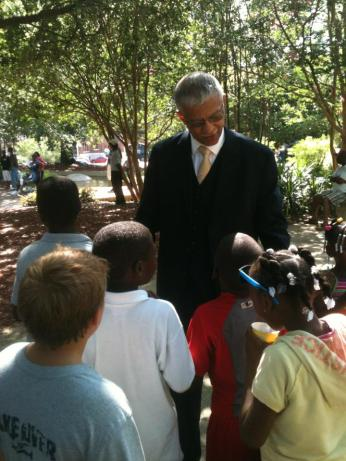 Mayor-elect Chokwe Lumumba with children in park at pre-inaugural block party