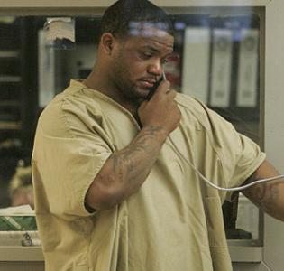 Black prisoner making phone call