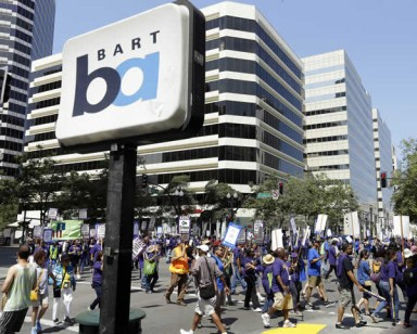Striking BART, City of Oakland workers close 14th & B'way 070113 by Ben Margot, web