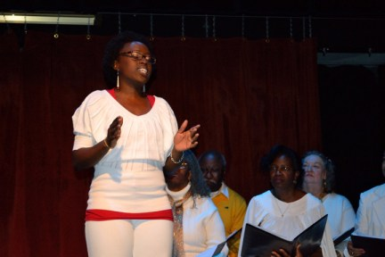 'Go Tell It!' Taiwo sings, Negro Spirituals Heritage Keepers behind her 1213 by JR, web