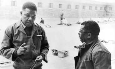 Nelson Mandela, Walter Sisulu in prison courtyard Robben Island