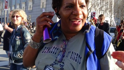 Homeless Day of Action marcher getting her groove on 011714 by Carol Harvey, web