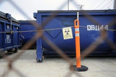 Navy's boxcar-like containers of radioactive soil Site 6 Avenue M Treasuer Island 1113 by Michael Short, Bay Citizen