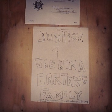 Sabrina Carter's eviction POOR 'Justice' sign 040814 by PNN