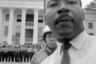 Martin Luther King Jr. constantly faced hostility from police, just as Mumia does today. Here, state troopers bar him from the Alabama Capitol on March 25, 1965. – Photo: AP