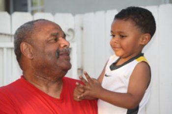 Uncle Carey gives nephew Marcelo, age 2, some pointers on life.