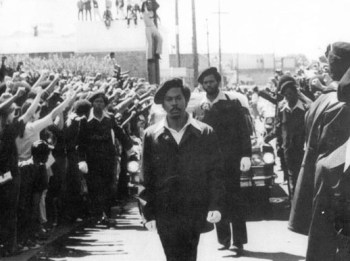 """People climbed telephone poles for a good view as 8,000 voices chanted, """"Long live George Jackson!"""" – Photo: Stephen Shames"""