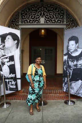 Wanda stands in front of huge posters of Maya Angelou at the entrance to Glide Memorial Church in the Tenderloin, where the San Francisco tribute she requested was held June 15. – Photo: TaSin Sabir