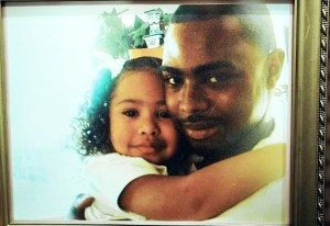 Oscar Grant III hugs his daughter Tatiana in this 2007 photo.