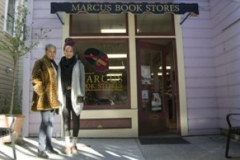 Karen Johnson and daughter Tamiko stand outside the officially landmarked Marcus Book Store a few months before it was ransacked by the Sweiss family. – Photo: Sara Bloomberg, KQED
