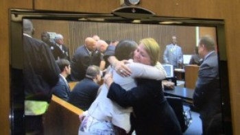 Monica McBride, mother of Renisha McBride, hugs Assistant Prosecutor Athina Siringas after the verdict. – Photo: Thandisizwe Chimurenga