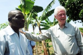 """Proud of his """"development"""" of an export economy – raising food for the world but none for the Haitian people – Bill Clinton visits a peanut plantation on Haiti's central plateau on June 29, 2014. – Photo: AFP"""