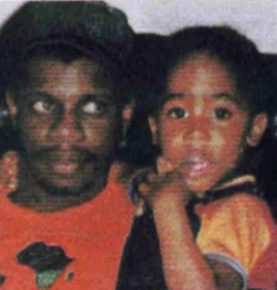 Dr. Mutulu Shakur holds his stepson, Tupac Shakur.