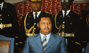 "In April 1971, at the age of 19, Jean-Claude ""Baby Doc"" Duvalier became president for life of Haiti upon the death of his father, Francois ""Papa Doc"" Duvalier. Though initially he was the youngest head of state in the world, Baby Doc presided over the murder and torture of thousands of Haitians and hundreds of thousands more fled the country during his 15-year reign of terror."