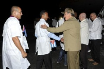 """According to the Washington Post, in its Oct. 4 story headlined, """"In the medical response to Ebola, Cuba is punching far above its weight"""": """"On Thursday, 165 health professionals from (Cuba) arrived in Freetown, Sierra Leone, to join the fight against Ebola – the largest medical team of any single foreign nation, according to the World Health Organization (WHO). And after being trained to deal with Ebola, a further 296 Cuban doctors and nurses will go to Liberia and Guinea, the other two countries worst hit by the crisis."""" Here, Raul Castro is proudly sending off the Cuban doctors as they board the plane for Africa."""