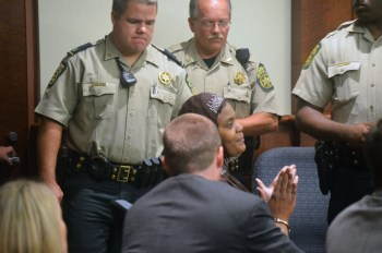 Sahara Fakhir listens as the jury verdict is announced Sept. 29, 2014. – Photo: Daniel Lumpkin, Douglas County Sentinel
