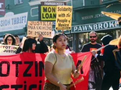 """Ayotzinapa Justicia"" reads the banner leading a large march in San Francisco's Mission District on Nov. 15. – Photo: Bill Hackwell"