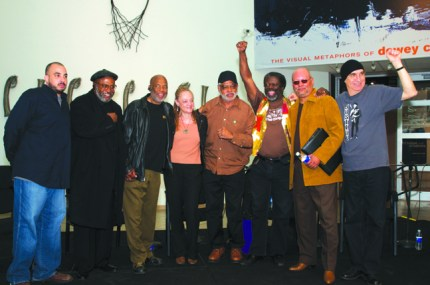 At the opening of an exhibit on the LAPD vs. the Black Panthers at the California African American Museum in Los Angeles on March 18, 2009, are Black Panthers Kathleen Cleaver, Roland Freeman, Michael D. McCarty and Robert Lee Johnson, Brown Berets co-founder Carlos Montes, moderator Yusef Omowale and photographer Howard Bingham.