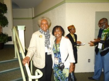 At FAMU are world renowned clinical psychiatrist and author Dr. Frances Cress Welsing with Wanda; Drs. Seawell and Washington are in the background. – Photo: Wanda Sabir
